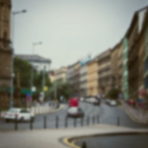 Vintage city building background. Town blur