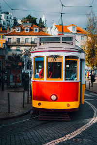 Vintage old red tram in the city center of Lisbon. City touristic landmarks of Lisboa Lissabon, Portugal
