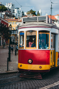 Vintage red tram in the city center of Lisbon. City touristic landmarks of Lisboa Lissabon