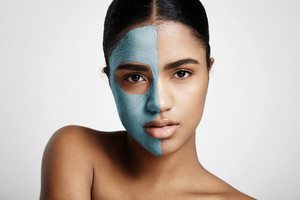vitamin facial mask. woman with a half of a face in a mask