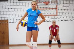 volleyball game sport with group of young beautiful girls indoor in sport arena school gym