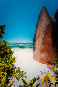 Walking pathway between big granite boulders on Anse Source D Argent beach, La Digue island Seychelles. Most famost location in the world. Vacation travel concept