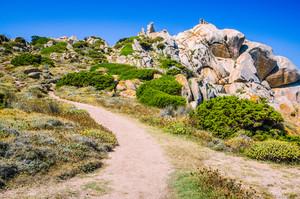 Walky path between bizarre granite rock formations in Capo Testa, Sardinia, Italy