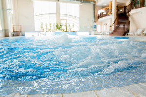 Waves and splashes in warm spa jacuzzi with nobody around