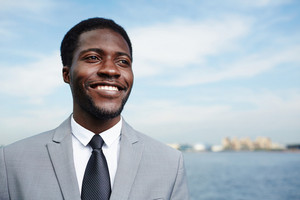 Well-dressed smiling businessman of African-american ethnicity