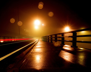 Wet and Rainy night on a bridge
