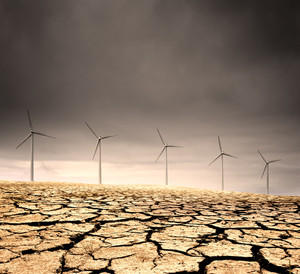 Windfarm in a barren cracked desert