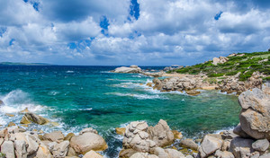 Windy costline with sandstone rocks near Costa Serena, Sardinia, Italy