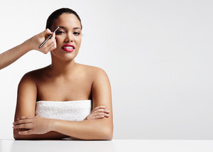 woman and hand, making a brow makeup
