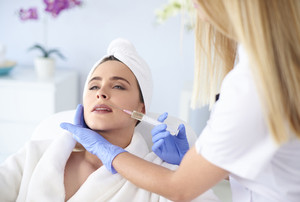 Woman at salon of medical aesthetics
