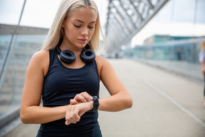 Woman Checking Heart Rate Using Smartwatch After Workout On Brid