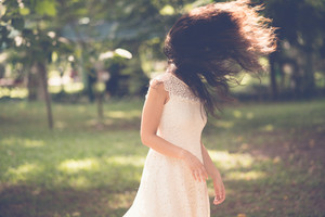 Woman flicking her hair outdoors