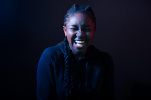 Woman Laughing Over Black Background
