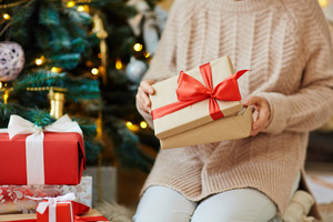 Woman opening gift-box with xmas present