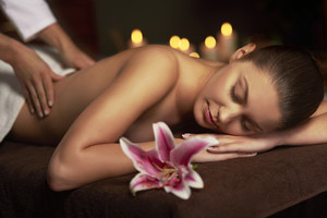 Woman paying visit at massage therapist