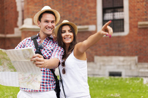 Woman pointing at something to her boyfriend during sightseeing