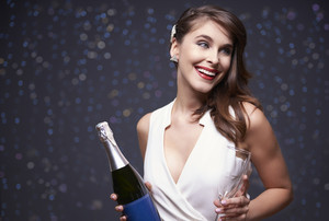 Woman ready to pour champagne