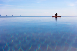 Woman Resting In Infinity Pool At a Aonang Beach Resort