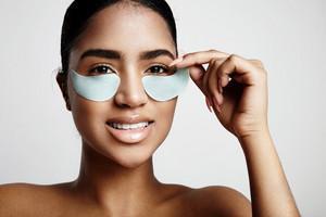 woman take off an eye patch