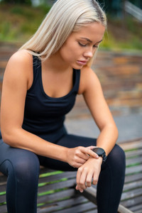 Woman Taking A Break After Workout And Checking Time On Smartwat