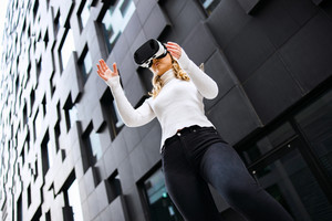 Woman Wearing Virtual Reality Glasses In City