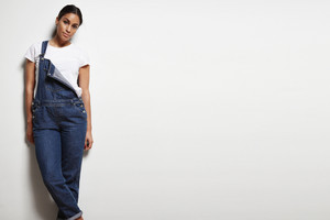 woman wears overalls on a white background