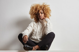 woman with a blond afro hair ha become entanged