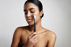 woman with a foundation on a brush