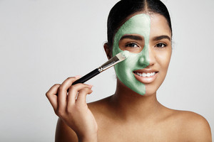 woman with a fresh green mask with avocado