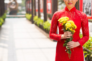 Woman with flowers in traditional dress