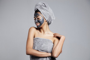 woman with grey coal clay facial mask on
