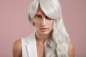woman with grey white coloured hair and fashion makeup