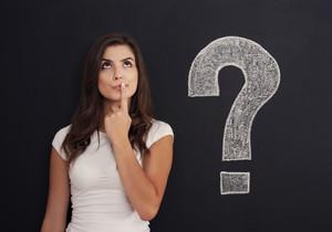 Woman with question mark on blackboard