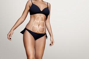 woman's body wearind dark blue swimsuit
