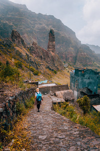 Women tourist walking down stone trekking route to Xo-Xo valley. Santo Antao Island Cape Verde. Travel Lifestyle concept adventure active vacations outdoor