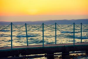 Wooden pier at the Balaton lake at sunset