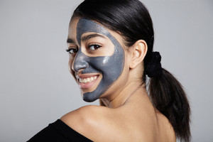 youmg woman with a half face facial mask