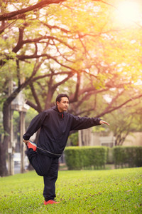 young asian man morning exercise in public park
