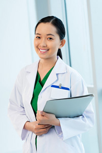 Young Asian woman doctor with a folder