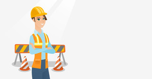 Young builder standing on the background of construction site with road barriers. Builder standing with arms crossed. Confident builder in hard hat. Vector flat design illustration. Horizontal layout.