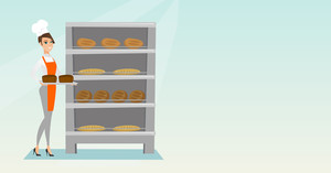 Young caucasian baker holding a tray with bread in a bakery. Confident baker standing near the bread rack. Smiling baker holding a baking tray. Vector flat design illustration. Horizontal layout.
