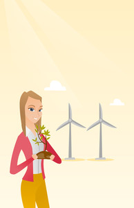 Young caucasian female worker of wind farm. Woman holding in hands green small plant in soil on the background of wind turbines. Green energy concept. Vector flat design illustration. Vertical layout.