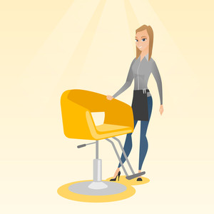 Young caucasian hairdresser standing near armchair. Full length of professional hairdresser standing at workplace. Friendly hairdresser at work. Vector flat design illustration. Square layout.