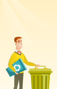 Young caucasian happy man carrying recycling bin. Smiling man holding recycling bin while standing near a trash can. Concept of waste recycling. Vector flat design illustration. Vertical layout.