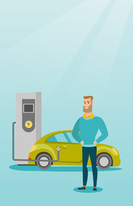 Young caucasian man charging electric car at charging station. Man standing near power supply for electric car. Charging of electric car. Vector flat design illustration. Vertical layout.
