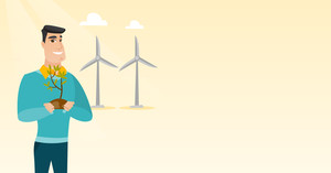 Young caucasian smiling worker of wind farm. Man holding in hands green small plant in soil on the background of wind turbines. Green energy concept. Vector flat design illustration. Horizontal layout