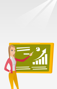 Young caucasian teacher standing in classroom. Teacher standing in front of the blackboard with piece of chalk in hand. Teacher writing on chalkboard. Vector flat design illustration. Vertical layout.