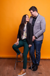 Young couple casually dressed smiling over yellow background. Funny couple . Beatiful couple.