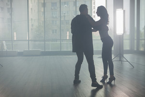 Young couple dancing kizomba with beautiful style and grace. Beautiful performance. Skillful dancers.