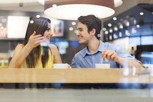Young couple have interesting discussion in cafe